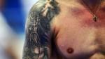 Deportistas dejan sus tatuajes al descubierto en el Mundial de Natación - Noticias de wisin